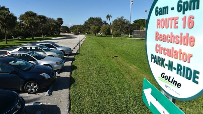 Cars are parked in the marked GoLine parking area, along the tennis courts and south of the boat ramps at Riverside Park in Vero Beach. (FILE PHOTO)