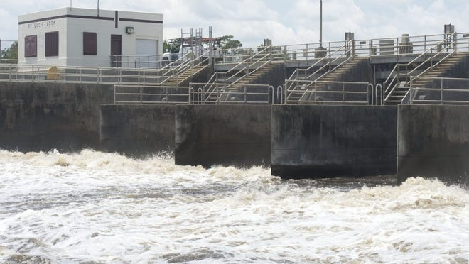 """Images of Lake Okeechobee water being released into the C-44 Canal, which leads to the St. Lucie River, at the St. Lucie Lock and Dam near Stuart on June 16, 2016. As of June 16, the amount of Lake Okeechobee water passing through the locks surpassed 136.1 billion gallons, the total amount for the entire year of 2013, or what was called """"the lost summer."""" (LEAH VOSS/TREASURE COAST NEWSPAPERS)"""