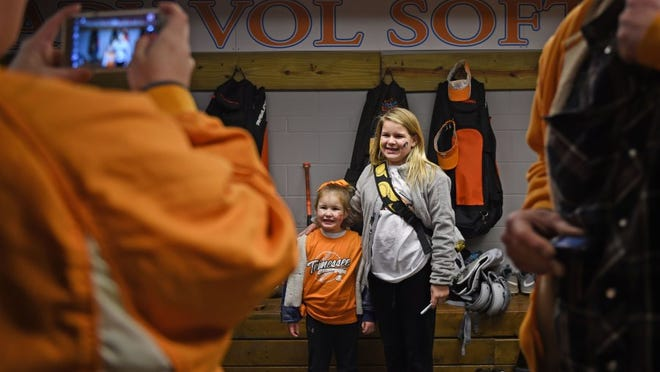 Aliah Garretson, 5, and Ally Houchins, 11 pose for a picture in the University of Tennessee softball team locker room in Sherri Parker Lee Stadium during the team's Meet and Greet on Feb. 6, 2016.