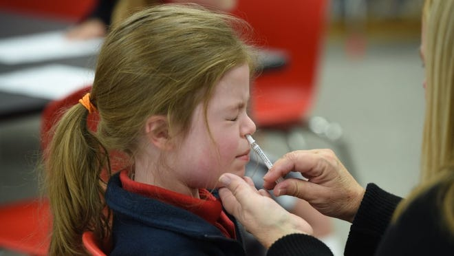 St. Joseph School first-grader Sophie Cuccia receives the FluMist vaccine in 2015, the last year FluMist was given in schools and day-care centers in Knox County. This year, the Knox County Health Department will again offer FluMist during its in-school clinics beginning Oct. 1.