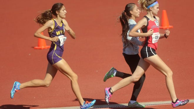Wylie's Hanna Sanchez, left, keeps pace with Levelland's Morgan McCutcheon, right, and Clint Mountain View's Michelle Estrada in the girls 3,200 meters at the Region I-4A meet in 2016 at Lowrey Field in Lubbock.