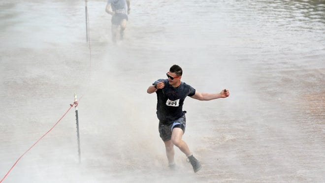 Times Record News file A T.H.O.R. participant tries to bound through the Wichita River while being blasted by an airboat. Runners can expect more than 20 obstacles.