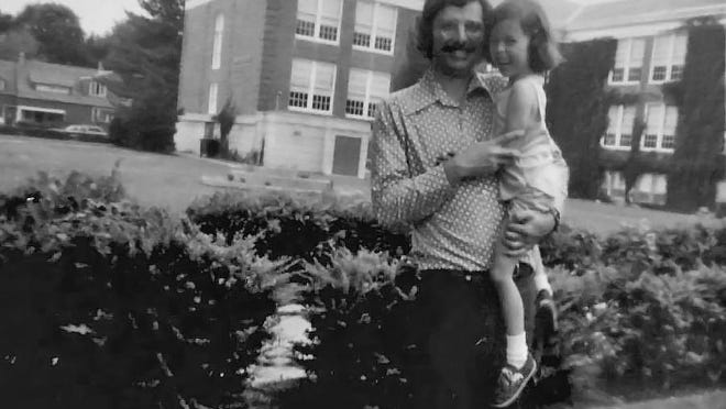 Bill Diehl, native of Corning, poses with his daughter in front of his alma mater, Northside High School, in an undated photo.