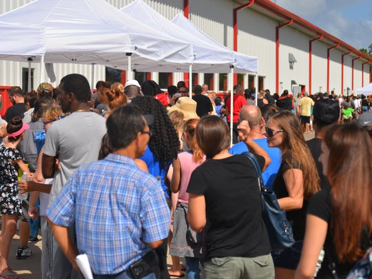 Thousands lined up in the hot sun at the Cocoa Expo Sports Center in October 2017 to sign up for the Food for Florida Disaster Food Assistance Program. More than 27,000 applications for post-Irma short-term aid were approved.