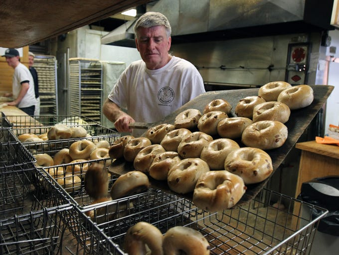 Dan Grimes, co-owner of The Hot Bagel Bakery, pours