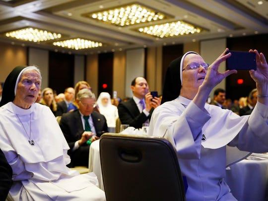 Sister Joseph Andrew Bogdanowicz, O.P., right, takes