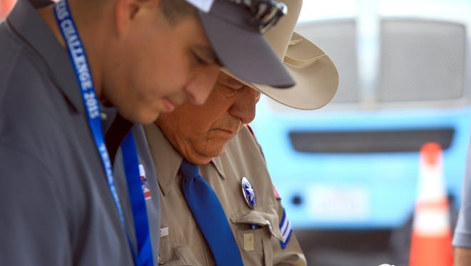 Cpl. Charlie Ramirez from the Texas Department of Public Safety takes notes as troopers prepare to compete in the Texas Challenge: Inspectors Competition June 23, 2015 at Del Mar College in Corpus Christi.