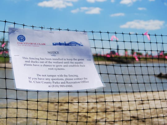 A notice explains fencing and streamers are temporary