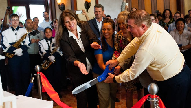 A ribbon is cut during the 15th anniversary celebration of the Hyatt Regency Coconut Point Resort and Spa in Bonita Springs on Wednesday, Sept. 21, 2016. The resort commemorated the anniversary with a performance by the Estero High School marching band, which played at the resort's opening shortly after the 9/11 attacks in 2001.