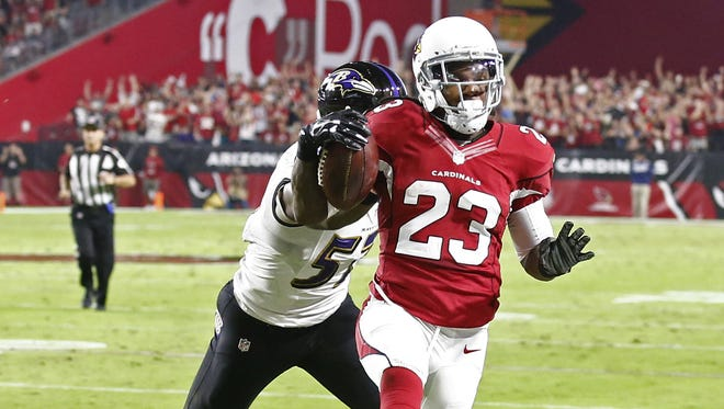 Arizona Cardinals running back Chris Johnson scores a touchdown against the Baltimore Ravens in the first half on Oct. 26, 2015 in Glendale, Ariz.