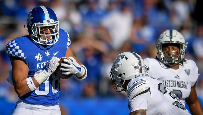 Eastern Michigan Eagles defensive back Juan Giraldo (32) sets to tackle Kentucky Wildcats wide receiver Charles Walker (88) during the game at Kroger Field on the campus of TheUniversity of Kentucky in Lexington, Ky, Saturday, September 30, 2017.