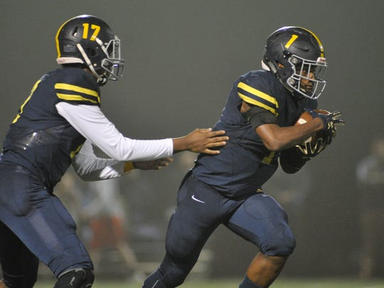 Northpoint Lausanne Lausanna Collegiate quaterback Schyler Forest (17) hands the ball off to Lausanna Collegiate running back Eric Gray (1) during first quarter action of their Division II-AA playoff game, Friday, November 3, 2017.