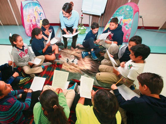2015: Eastwood Knolls students go over essays for the