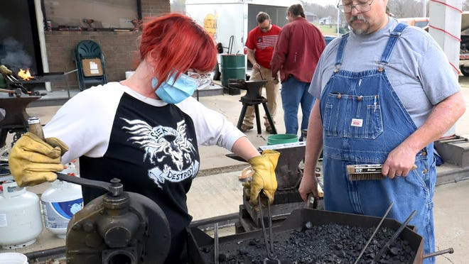 """Sondra Hawk of Tulsa, left, gets help with crafting a fennel from blacksmith Tracy Cowert, during a Beginners' Blacksmith Workshop, Saturday, Nov. 14, at Muldrow City Park. Hosted by Saltfork Craftsmen Artist-Blacksmith Association, students learned to taper, draw, twist and heat treat as they completed """"S"""" hook, leaf, and a hot cut chisel projects."""