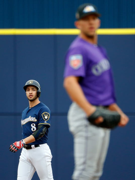 Colorado Rockies pitcher Tyler Anderson looks for the sign as Milwaukee Brewers' Ryan Braun leads off second during the first inning of a spring training baseball game Saturday, March 10, 2018, in Phoenix. (AP Photo/Matt York)