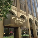 The nine-story International Building is back on the market after a proposed sale fell through.
