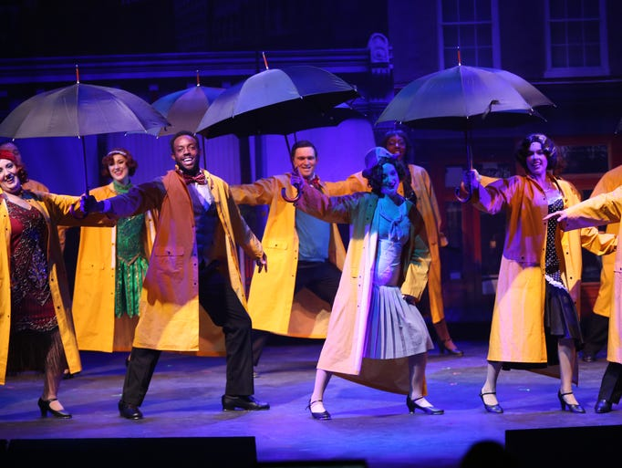 The cast performs a song and dance number in the High