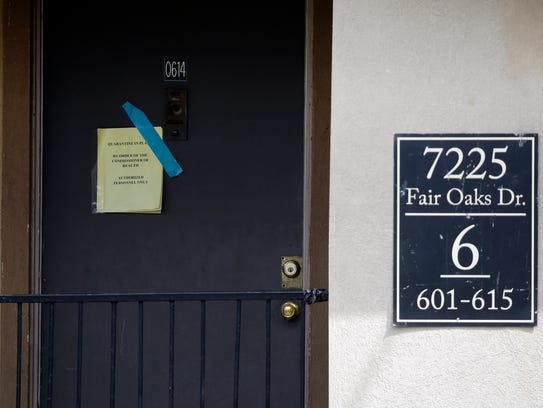A sign on the door of the Dallas apartment where Thomas