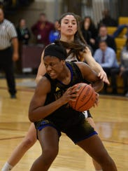Marian's Uche Ike grabs a rebound with authority in