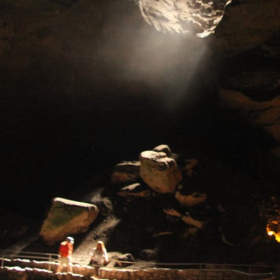 Visitors stood in a shaft of light that appeared in