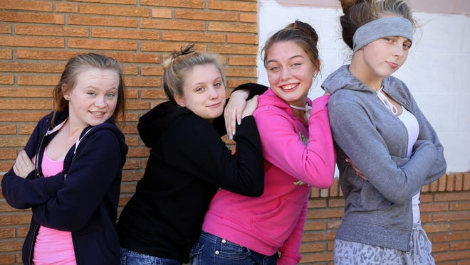 From left to right: Sam Bowlin, 14, Hailey Johnson, 14, Kelsey McLean, 16, and Raven O'Toole, 15, are friends who have spent most of their lives in Lower Price Hill. They know the neighborhood well, both good and bad.