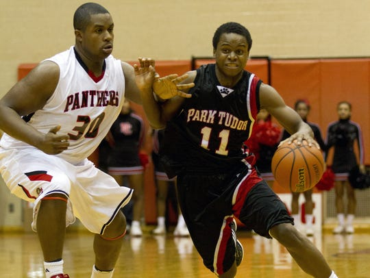 Park Tudor's Kevin Ferrell (11), right, works to get