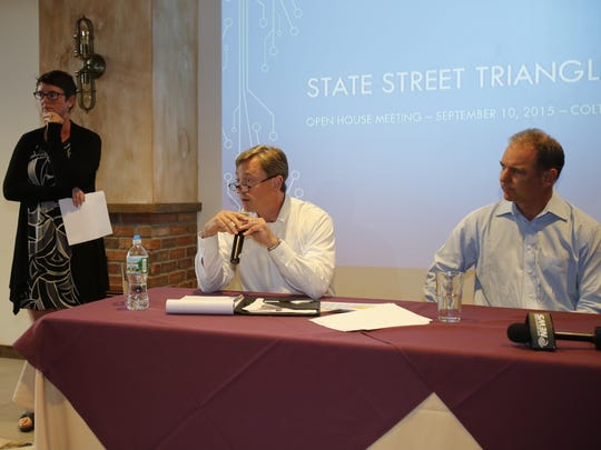 Campus Advantage President and CEO Michael Peter, left, and Ronnie Macjiewski, right, address the questions of locals.
