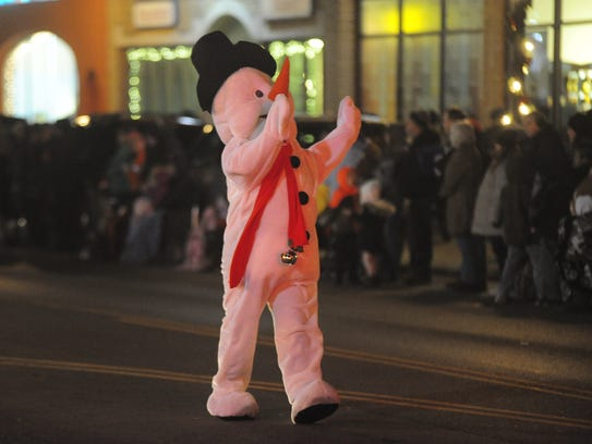 A snowman danced his way through town Friday during