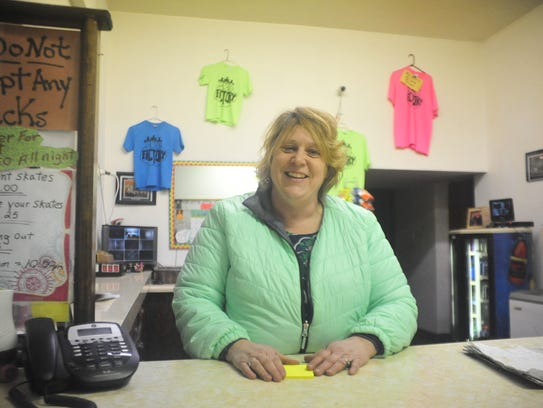 TeniaThoroughman stands behind the snack counter at