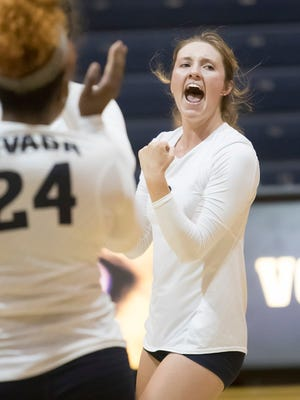 Nevada putting more money into sports like volleyball and softball would be wise. Above, Lyndsey Anderson celebrates a point during a Wolf Pack volleyball match this season.