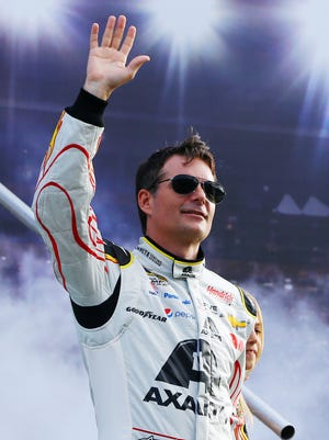 Jeff Gordon greets the crowd for the final time during driver introductions before the Sprint Cup finale.