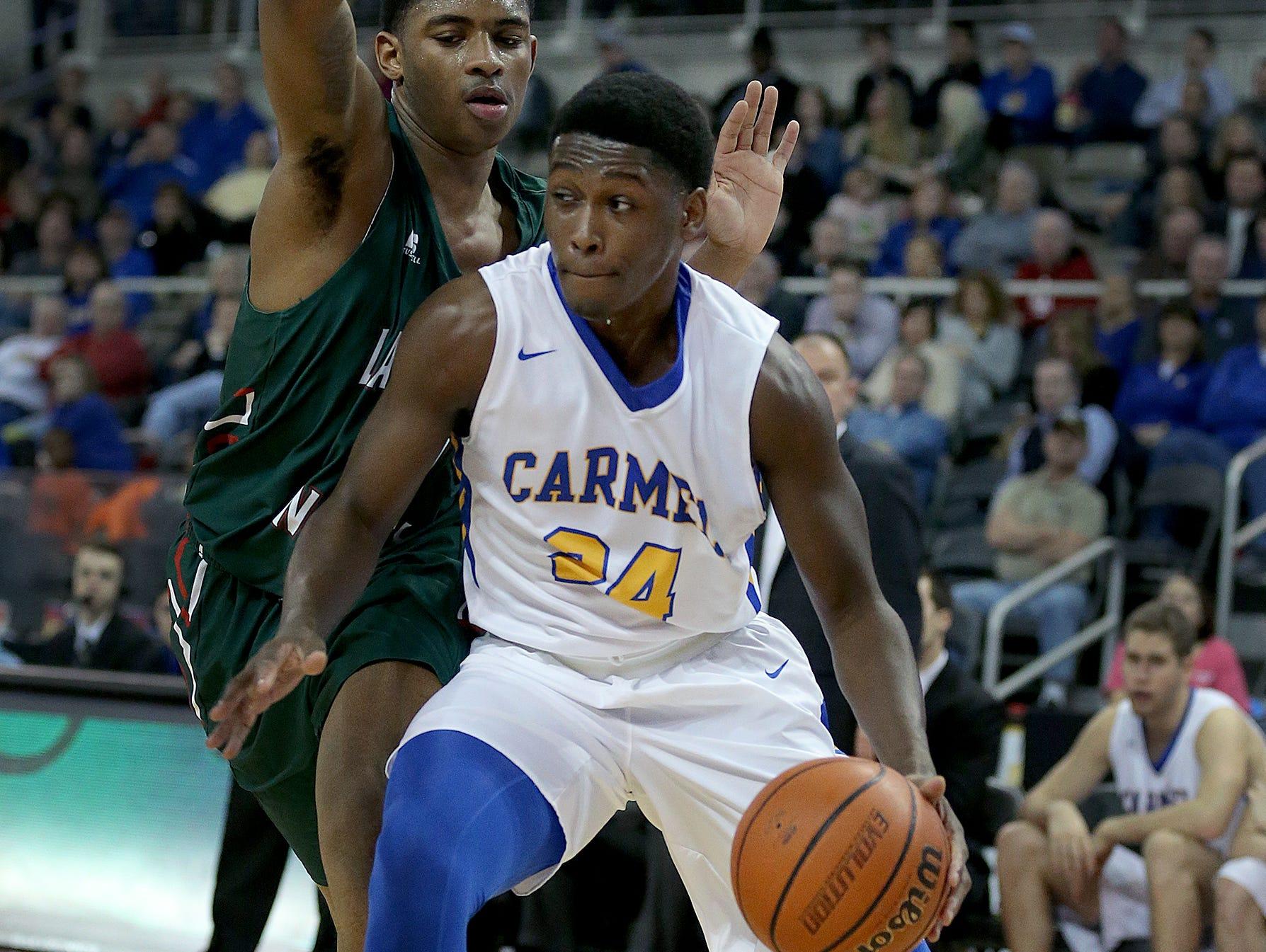 Carmel's Garrett Covington (24) drives on Lawrence North's Kevin Easley Jr. on Feb 4, 2016 at the Indiana Farmers Coliseum.