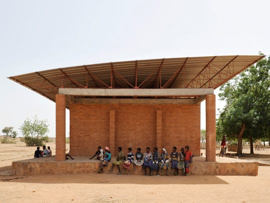 A primary school in Gando, Burkina Faso, completed 2001, was designed by Francis Kéré, Burkinabe.