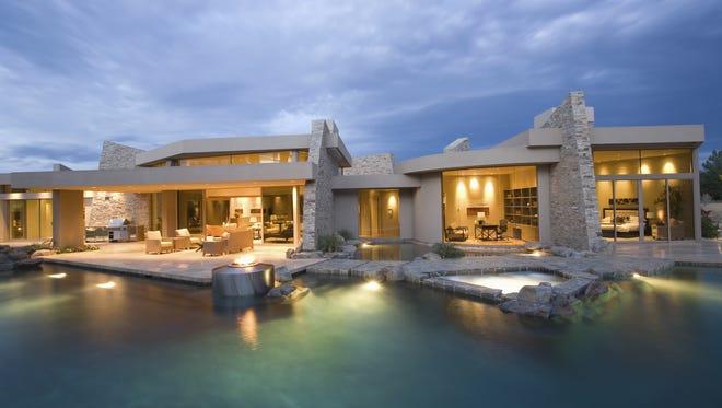 Swimming Pool And Illuminated Modern House