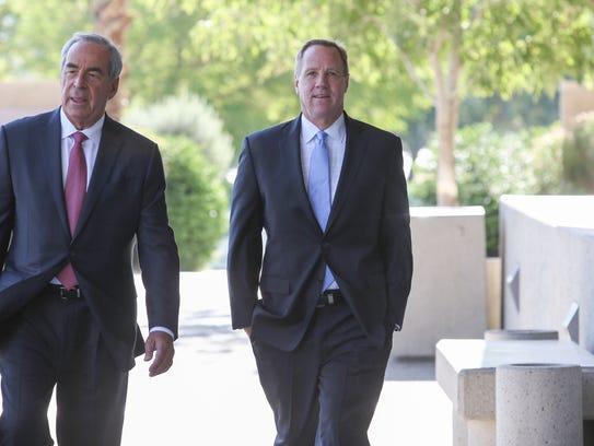 Former Palm Springs mayor Steve Pougnet, right, walks