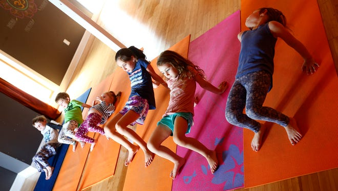 Students participate in a session run by Alice Balzarini during the yoga class for kids at Coba Yoga in Little Silver.