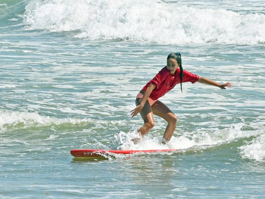 Jasmine Almeda in the amateur competition. Easter Pro-Am surfing at Lori Wilson park in Cocoa Beach on Sunday.