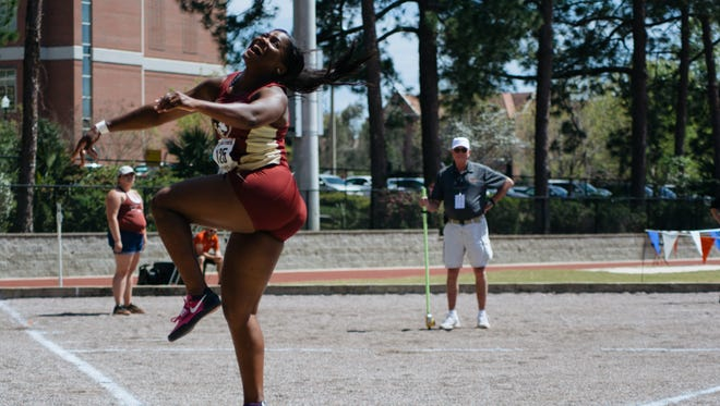 Florida State senior Gleneve Grange makes a throw at the Mike Long Track on Friday March 24, 2017.