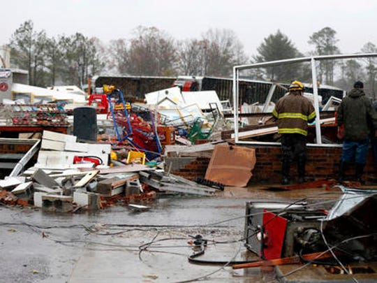 In this Nov. 30, 2016, file photo, a Rosalie firefighter helps remove debris from the Rosalie Plaza after a tornado ripped through the town in Rosalie, Ala. The most extreme tornado outbreaks, like the deadly one Tuesday in the Southeast, are mysteriously spawning many more twisters than they did decades ago, a new study claimed. The same type of once-every-five-years-or-so outbreak that 50 years ago had about 12 tornadoes, now has on average about 20, said Columbia University applied physics professor Michael Tippett, lead author of the study in Thursday's journal Science.