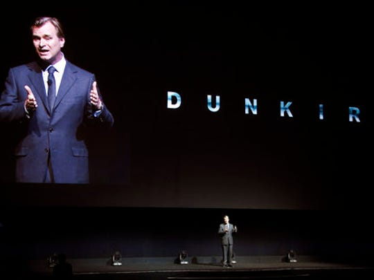 "FILE - In this Wednesday, March 29, 2017, file photo, Christopher Nolan, director of the upcoming film ""Dunkirk,"" discusses the film onstage during the Warner Bros. Pictures presentation at CinemaCon 2017 at Caesars Palace in Las Vegas.  His latest film, ""Dunkirk"" takes him out of the fantasy world and into reality and the evacuation of the Allied soldiers from that beach in France in May and June of 1940.  Nolan spoke to The Associated Press about ""Dunkirk,"" which sails into theaters on July 21."