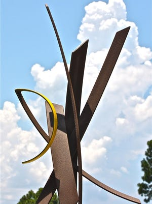 "Rubio's ""Yellow Rose for my Guardian Friend"" is a 20.5-by-7.5-by-6.5-foot steel sculpture that incorporates cold texture paint."