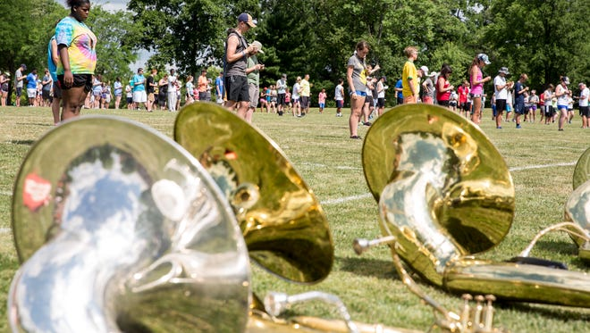 Marching band members for Music for All's 2016 summer symposium learn drill on the University Green.