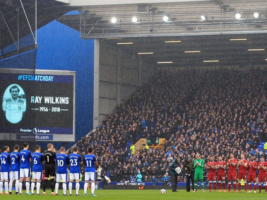 Everton and Liverpool players hold a minute's silence in memory of the late Ray Wilkins before the Premier League soccer match between Everton and Liverpool at Goodison Park, Liverpool England. Saturday, April 7, 2018. (Peter Byrne/PA via AP)
