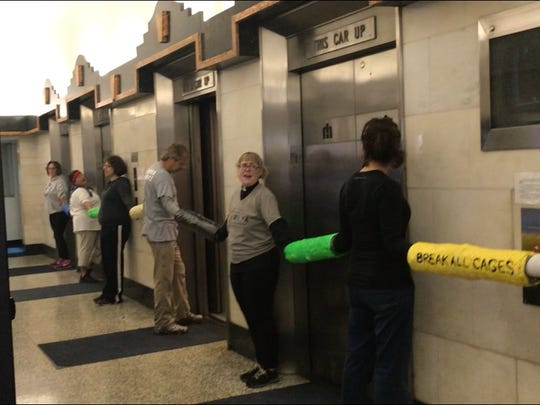 Protesters calling for the end of ICE blocked elevators at the Heyburn Building on Thursday morning where Louisville Immigration Court is held.