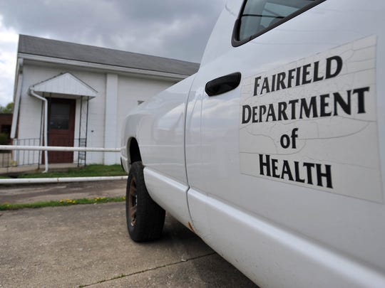 A Fairfield County Health Department truck sits in the parking lot outside the Cross Pointe Free Will Baptist Church Family Life Center Wednesday, April 22, 2015, in Lancaster. One person is dead and more than a dozen people are in area hospitals after a suspected outbreak of botulism that officials believe is tied to a lunch Sunday at the church.