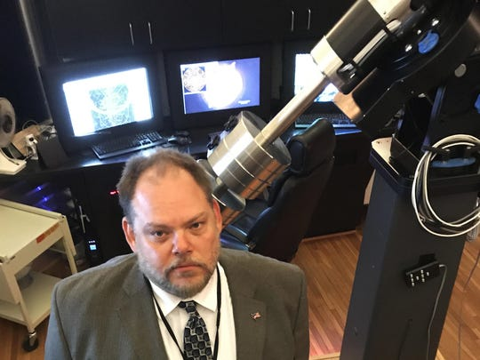 Michael Narlock, Cranbrook Institute of Science head of astronomy, shows the telescope that will be available for visitors to see the sun during Monday's eclipse.