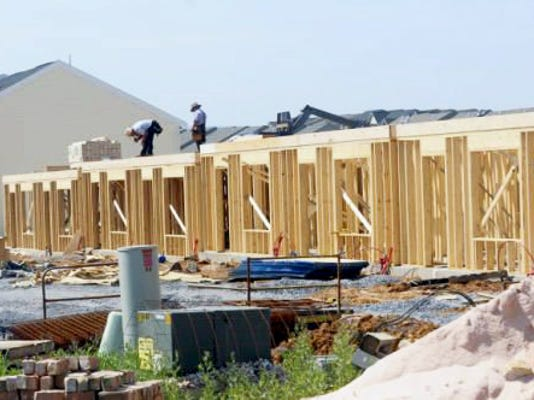Construction of town houses and duplexes continued on Lantern Avenue in June 2014. Today, property taxes account for most of the county's revenue.