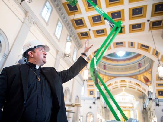 Father David Boettner points out details inside the new Cathedral of the Most Sacred Heart of Jesus on Northshore Drive in Knoxville on Tuesday, Feb. 13, 2018.