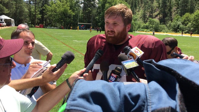 Arizona State offensive lineman Chip Sarafin speaks to reporters Thursday at Camp Tontozona.