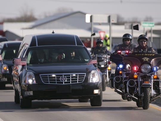 The hearse carrying the body of Boone County Sheriff's Deputy Jacob Pickett enters Lebanon, Friday, March 9, 2018.